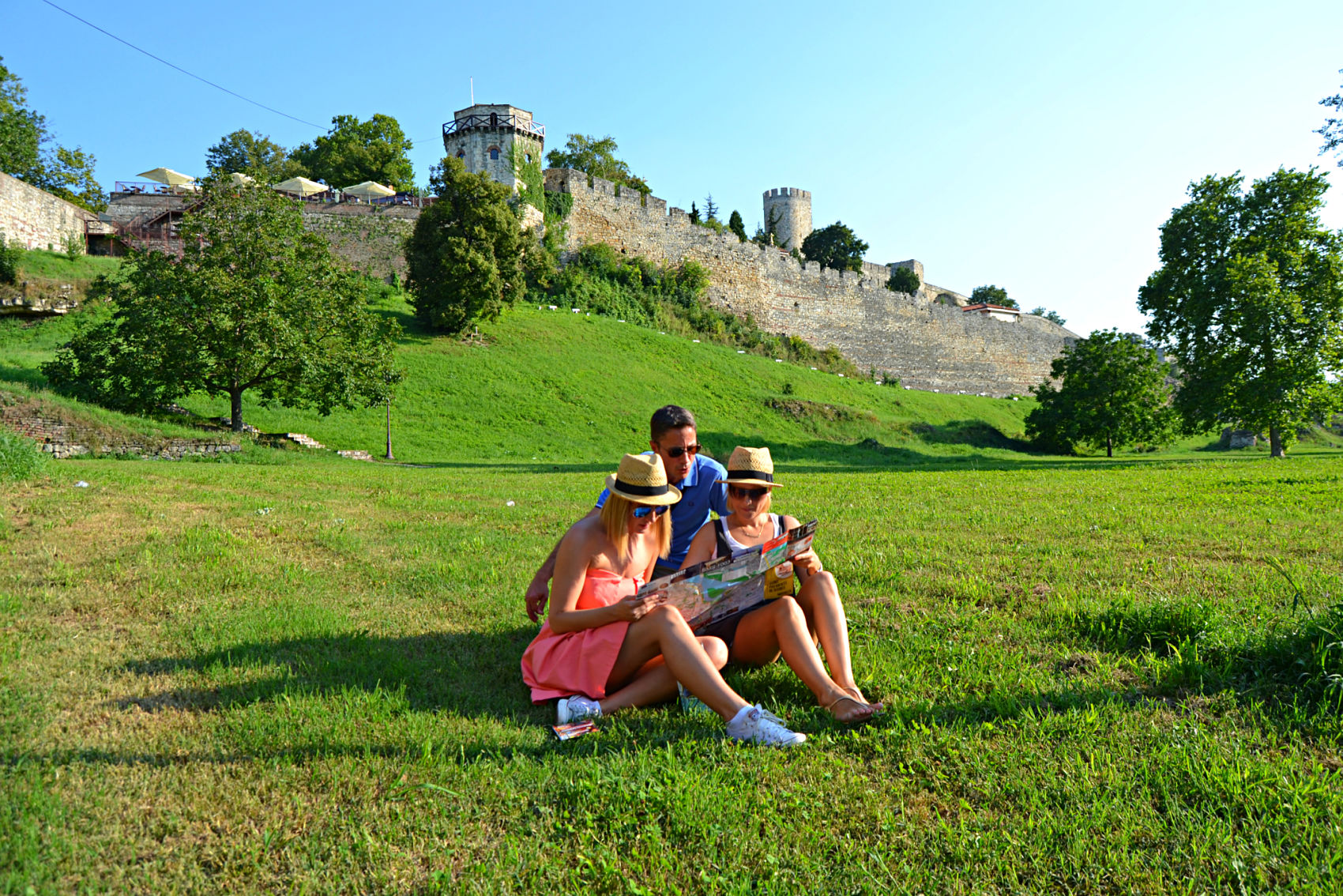 Young people siting the park in fron of Kalemegdan Fortress,Belgrade
